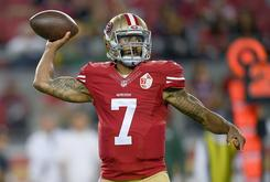 Colin Kaepernick Takes The Field In Socks That Depict Cops As Pigs