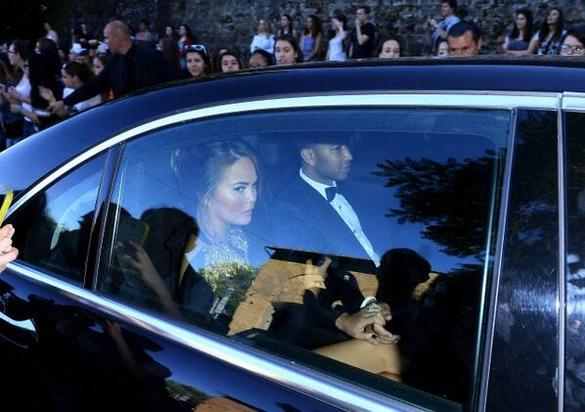 John Legend and Chrissy Teigen leaving the ceremony