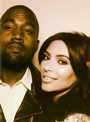 Kanye and Kim in a photobooth at the wedding