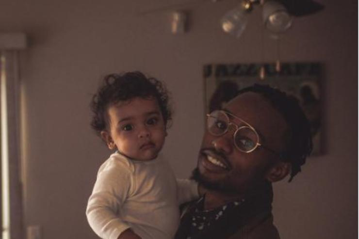 Rob $tone holds his baby.