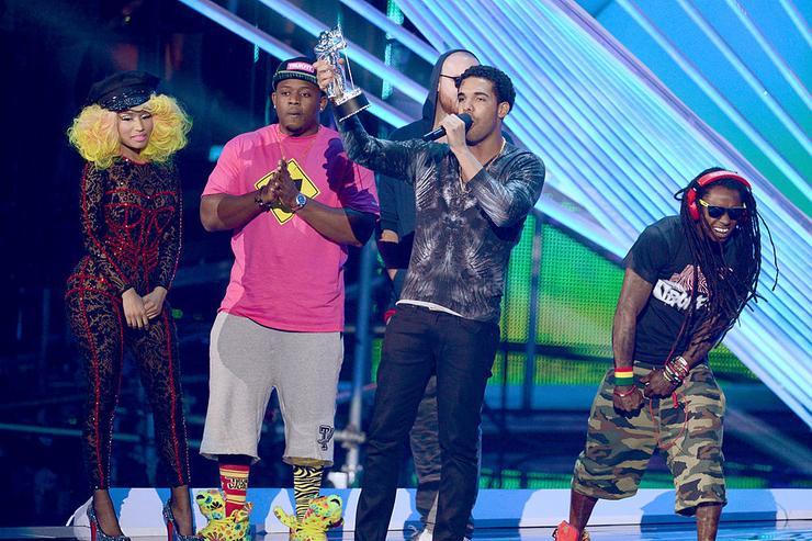 (L-R) Singer/rapper Nicki Minaj and rappers Drake and Lil Wayne accept the award for Best Hip Hop Video onstage during the 2012 MTV Video Music Awards at Staples Center on September 6, 2012 in Los Angeles, California.