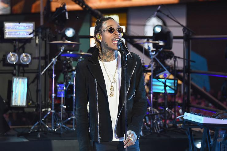 """Wiz Khalifa performs """"See You Again"""" on stage with singer Charlie Puth at the Dick Clark's New Year's Rockin' Eve with Ryan Seacrest 2016 on December 31, 2015 in New York City."""