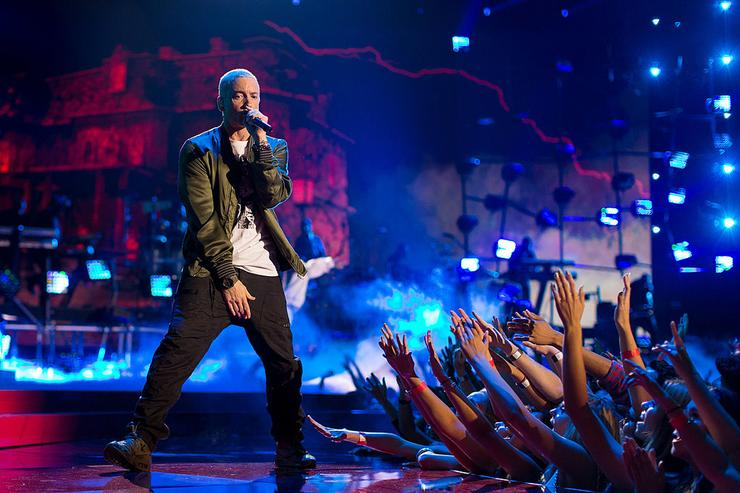 Eminem performs onstage at the 2014 MTV Movie Awards at Nokia Theatre L.A. Live on April 13, 2014 in Los Angeles, California.