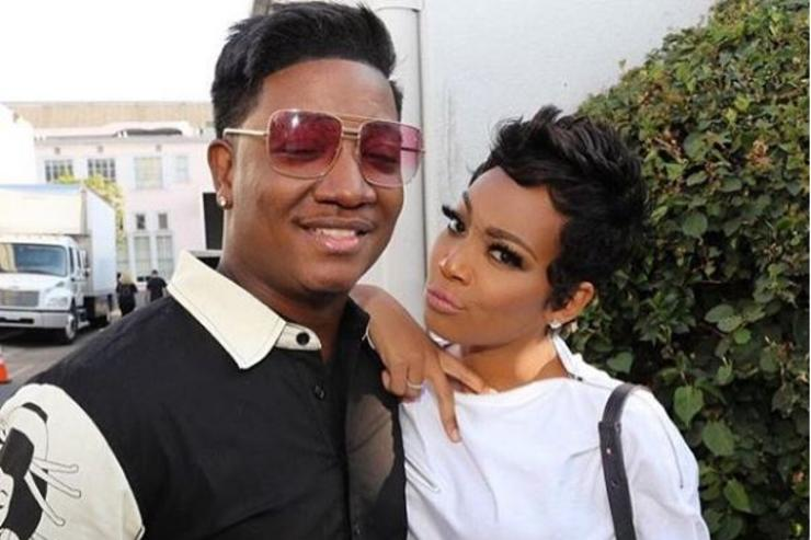 Yung Joc and Monica pose for a promotional photo for VH1's Hip Hop Squares.