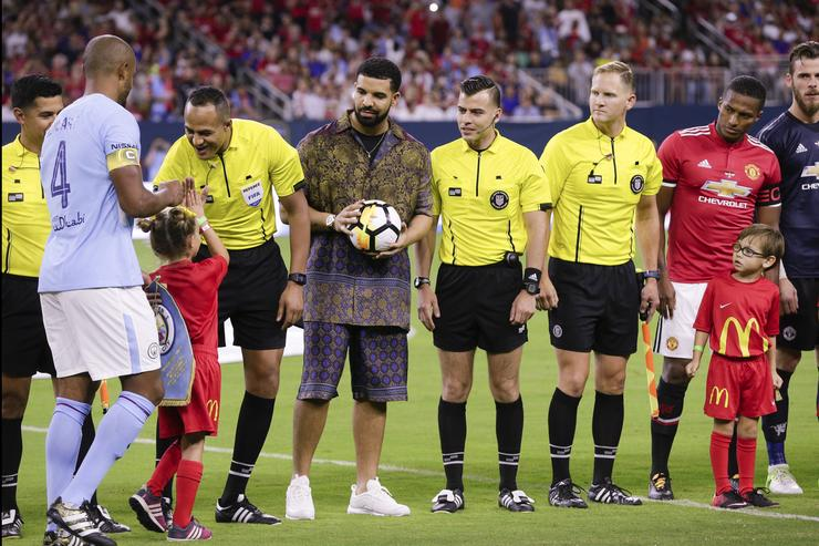Rapper/Singer Drake brings out the game ball with the officials at NRG Stadium on July 20, 2017 in Houston, Texas.